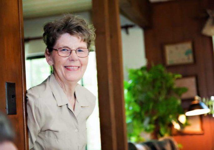 mom smiling in doorway